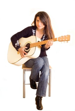 female musician playing an acoustic guitar .