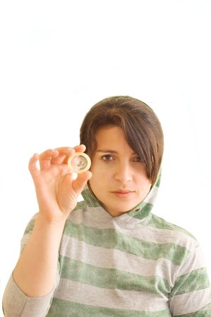 Adolescent female holding a condom. Stock Photo - 3181464