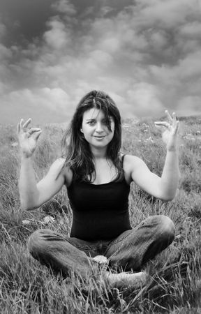 black and white of woman meditating