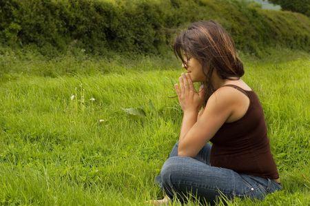 prengnant woman praying Stock Photo