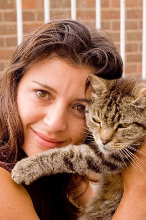 young lady with old tabby cat