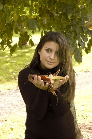 woman holding autum leave in hands