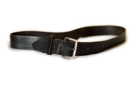 an old worn black leather belt with buckle