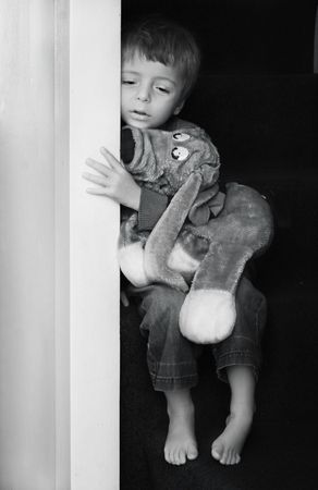 Impression of sad little boy in black and white.