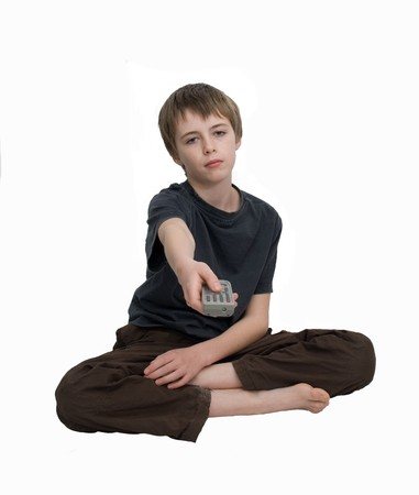 A bored sad looking child with remote. Stock Photo