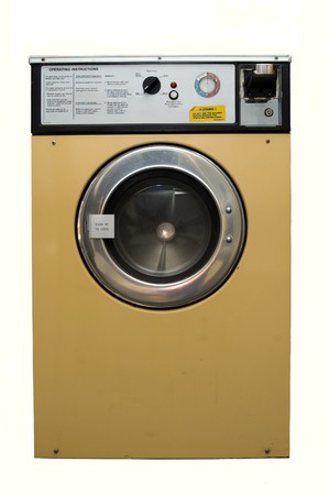 a dirty well used coin operated launderette washing mchine.