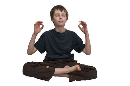 an isolated image of a child sitting in the meditation postition.