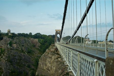 an image showing isambard kingdom brunels famous landmark the Clifton suspention bridge, with the camera obscura (observatory) in the background, overlooking avon gorge.