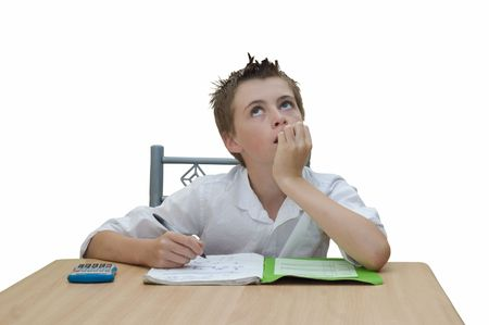 an image of a student looking upwards and biting his finger nails while trying to work out a problem. Stock Photo