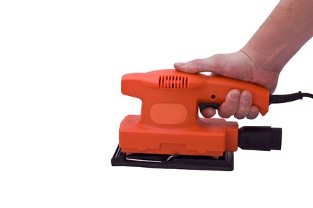 an isolated over white caucasian human hand holding an orange electric sander.
