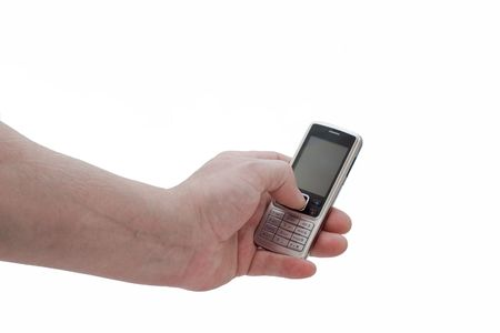 an isolated over white mans hand using a mobile phone. Stock Photo