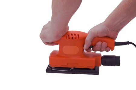 an isolated over white image of a Orange orbitol sander being held by two caucasian male hands. Standard-Bild