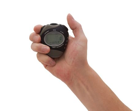 an isolated over white caucasian man's hand holding a well worn old stopwatch poised to press the start or stop button
