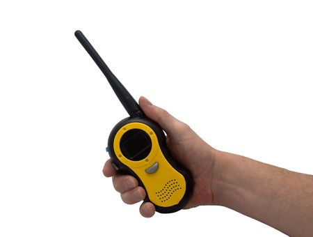 an isolated over white caucasian mans hand holding and pressing a button on a walkie talkie  2 way radio.
