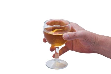 an isolated over white image of a caucasian mans hand holding a glass of liquid possibly white wine, apple juice, cider, etc
