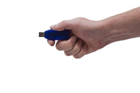 an isolated over white image of a caucasian mans hand holding a blue USB pen drive.
