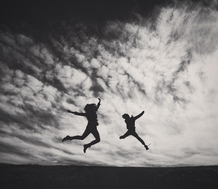 A Boy and a Mom Jumping in the Air