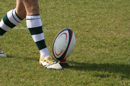 rugby player kicking ball Stock Photo