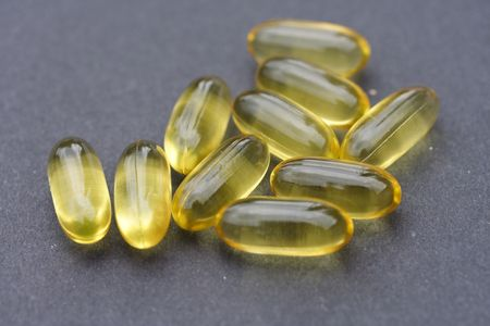 primrose oil: evening primrose oil capsules Stock Photo