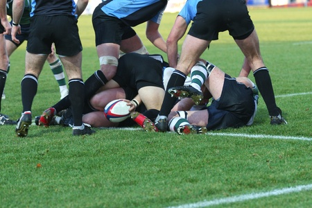 rugby being played by men on a grass pitch Editorial