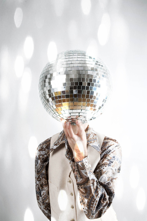 mirrorball: Instagram filtered image of a man holding a disco ball