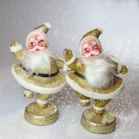 Pair of Vintage dancing Frock Santa Claus Stock Photo - 63226264