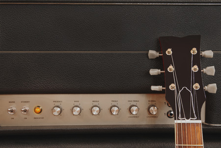 detail close up of a guitar leaning against an amplifier Imagens