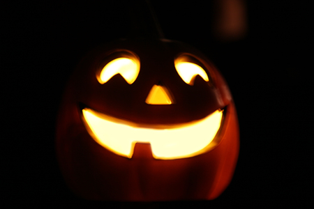 image of a smiling Halloween jackolantern decoration glowing in the evening