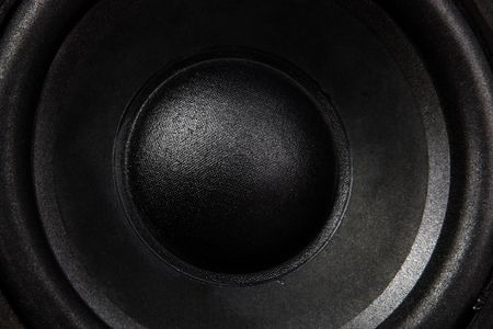 A close up of a black bass speaker
