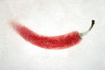 Frozen Red peppers in white ice