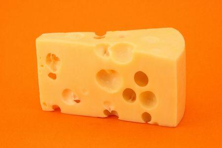 Cheese isolated on orange background