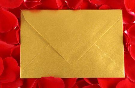 Gold envelope on Red Rose petals