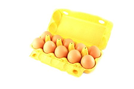 ten eggs in a yellow box on white background