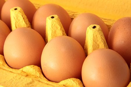 Eight eggs in a yellow box Stock Photo