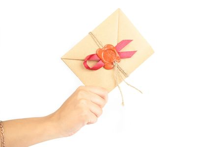 hand with Antique envelope on white background Stock Photo