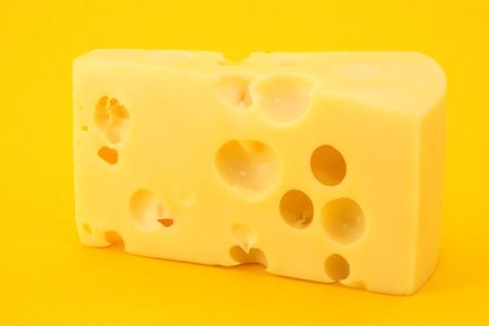 Cheese on yellow background