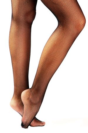 Woman legs in black stockings isolated on white