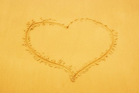 Heart drawed on sand photo