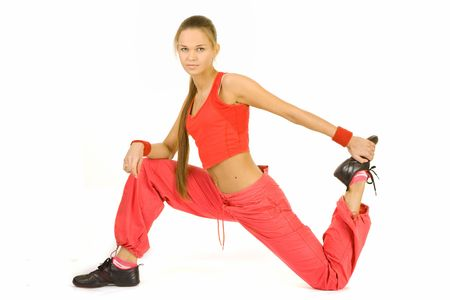 Girl in a sports suit does sports exercises Stock Photo