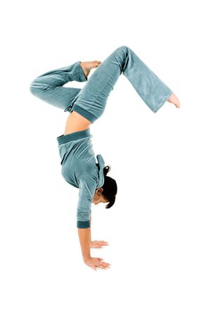 actively: An isolated view of an agile gymnast doing a graceful handstand. White background