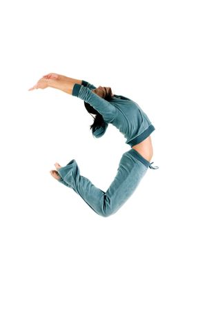 Side view of female gymnast in mid-air, isolated on white background.