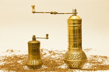 Cumin seed with one large and one small spice grinder