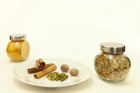 Tumeric,cinnamon sticks, nutmeg, cardamon pods and coriander seeds Stock Photo