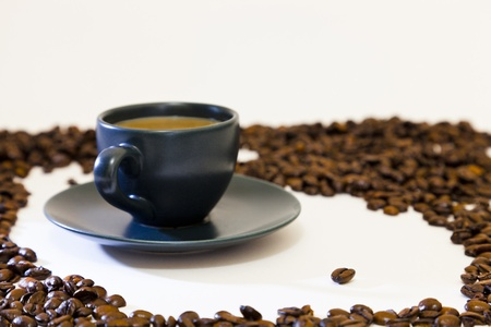 That special cup of coffee. Espresso coffee cup and saucer and one select coffee bean surrounded by a ring of beans