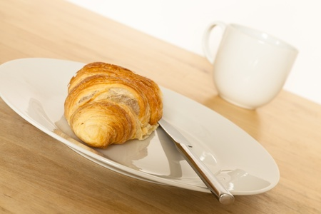 Croissant and coffee for breakfast