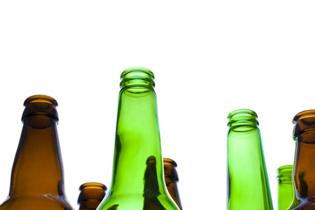 Looking up at empty green and brown beer bottles with a white background. Stock Photo