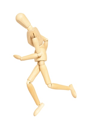 Wooden mannequin arranged as if running. Isolated on a white background. photo