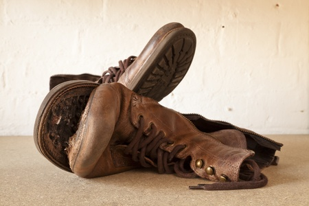 Worn out old boots, one with the sole coming off Stock Photo - 12962926