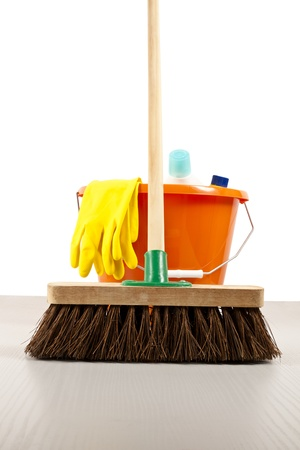 Broom and other cleaning materials ready to sweep and clean the floor