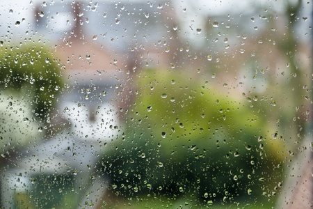 Rain on a window in an urban area with the distance out of focus Stock Photo - 13282920